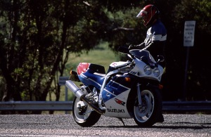 Racing riding position necessitates regular stops.