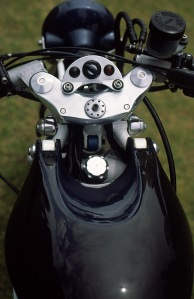 Shear pins are used to secure the handlebars in place.