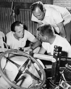 Campbell (left )in discussion with Mickey Thompson (right). Thompson played on Campbell's surreptitious nature.