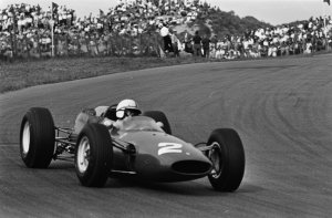 Surtees pushes the Ferrari 158 to second place behind Jim Clark's Lotus at Zandvoort in Holland 1964.