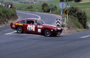 Sherman and Walkley attack the Paris Creek hairpin.