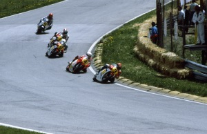 Randy Mammal on the NS500 V3 leatds Eddie Lawson on the Yamaha V4 Yamaha, Ron Haslam V3 Honda and Spencer V4 Honda.