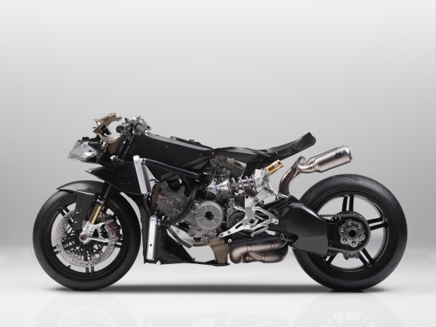 Carbon fibre monocoque chassis uses the engine as a stressed member.