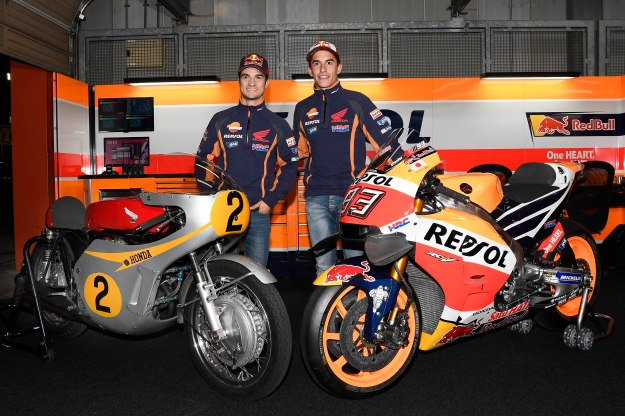 Dani Pedrosa and Marc Marquez pose with the 1966 Honda RC181 and the 2016 RC213V.